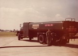 Refueling a refueler by hosecart, pad 42 looking east. Submitted by Frank Parnell, 20th Supply Sq. (POL), Feb 1977 - Mar 1978.